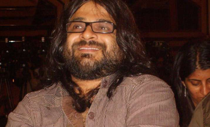 Pritam reveals what it is like working with Karan Johar
