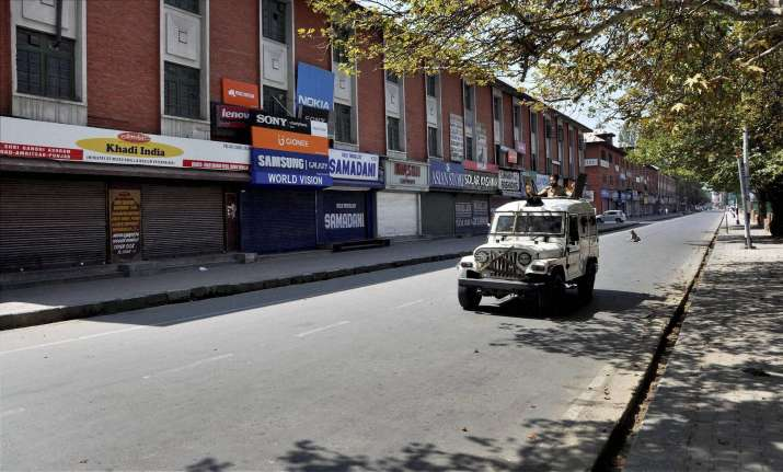 Police personnel patrol near Lal Chowk in Srinagar on Friday