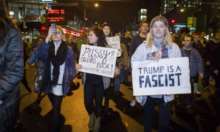 Thousands of protestors chant anti-Trump slogans across US