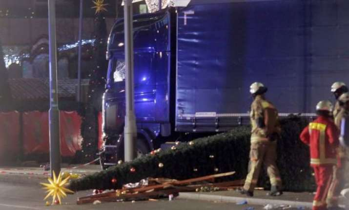A fallen christmas tree lay beside crashed Lorry in Berlin