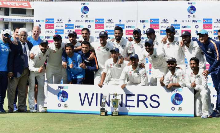 Indian cricket team and support staff after defeating