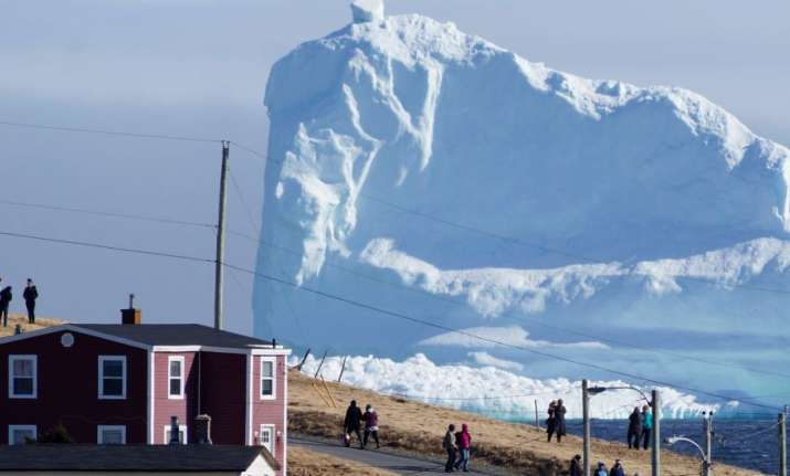A 150-feet iceberg floats past Canadian village