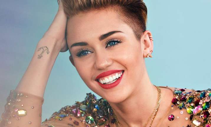 Miley Cyrus dedicates song to Ariana Grande and victims of