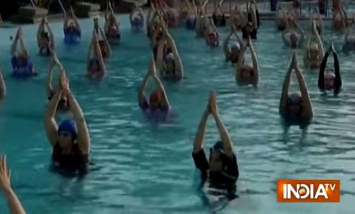 1000 women practice water yoga