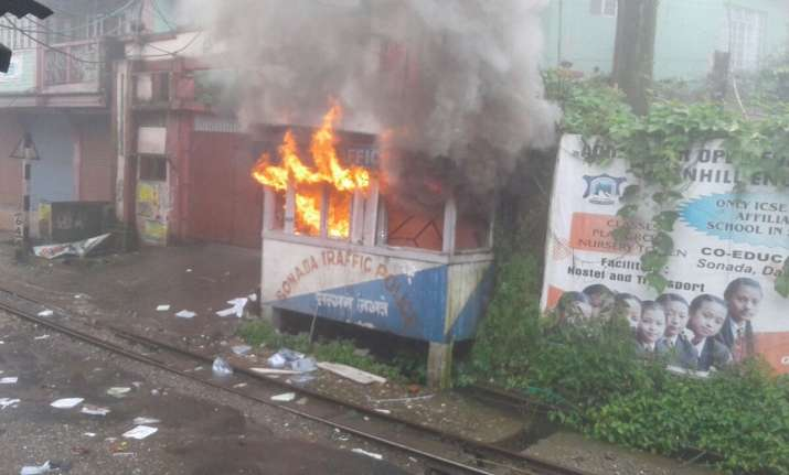 File pic:GJM supporters set a police outpost ablaze in