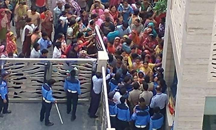 An angry mob pelted stones, breached the society gate and