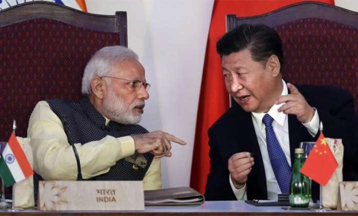 China says India should show willingness for peace through