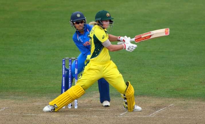 Sushma Verma looks on as Australia's Meg Lanning hits a shot