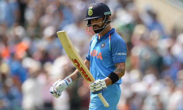 Virat Kohli of India leaves the field after being dismissed