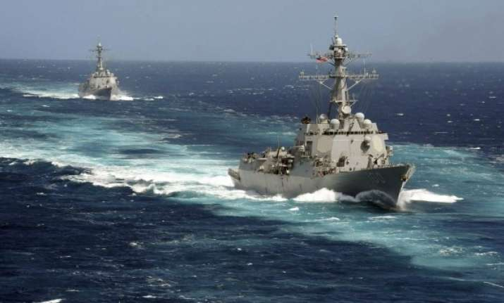 As tensions heighten, Chinese warships slink in Indian