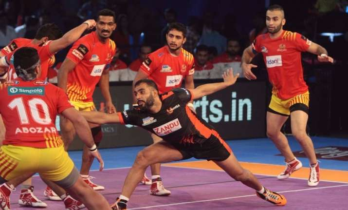 Bengaluru bulls vs up yoddha and u mumba vs gujarat fortunegiants image source wesbite pro kabaddi u mumbas skipper anup kumar tries to raid the gujarat fortunegiants defence thecheapjerseys Gallery