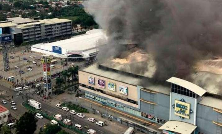 Dozens feared dead in Philippine mall inferno in President