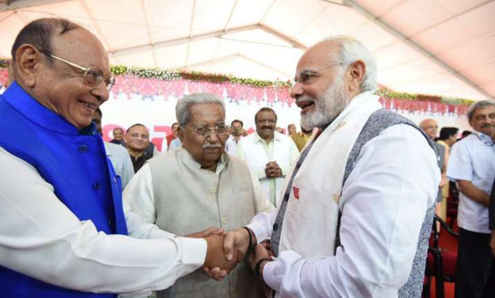 Vaghela was greeted by PM Modi at Rupani's swearing--in