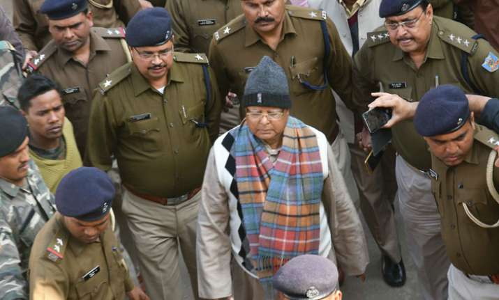 Bihar's former chief minister Lalu Yadav escorted by police