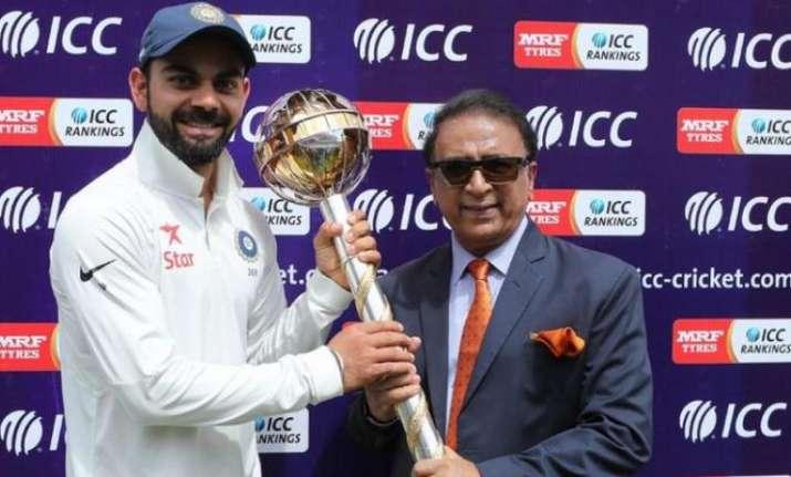 A file image of Virat Kohli holding the ICC Test mace