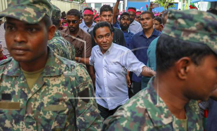 Maldivian president Yameen Abdul Gayoom, center, surrounded