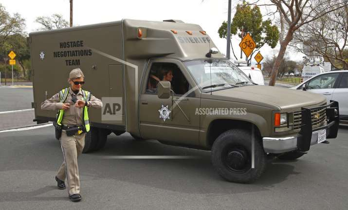 A sheriff's hostage negotiation team passes a California