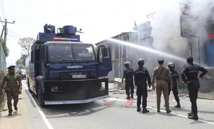 Ambatenna Sri Lankan police officers attempt to douse