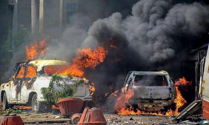 Smoke billows out of burning cars during 'Bharat Bandh'