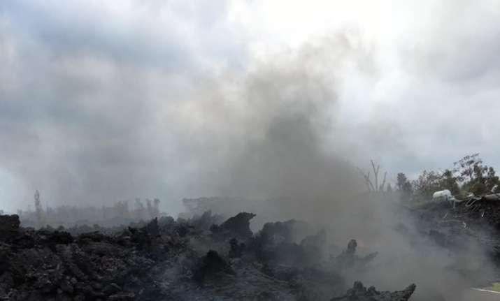 Lava burns across the road in the Leilani Estates in Pahoa,
