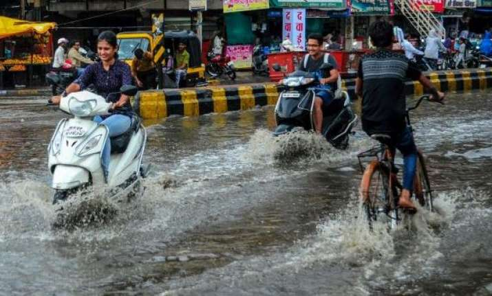 Waterlogged street during heavy rainfall, in Nagpur,