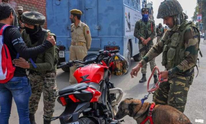 Srinagar: CRPF personnel check vehicles and motorcycles