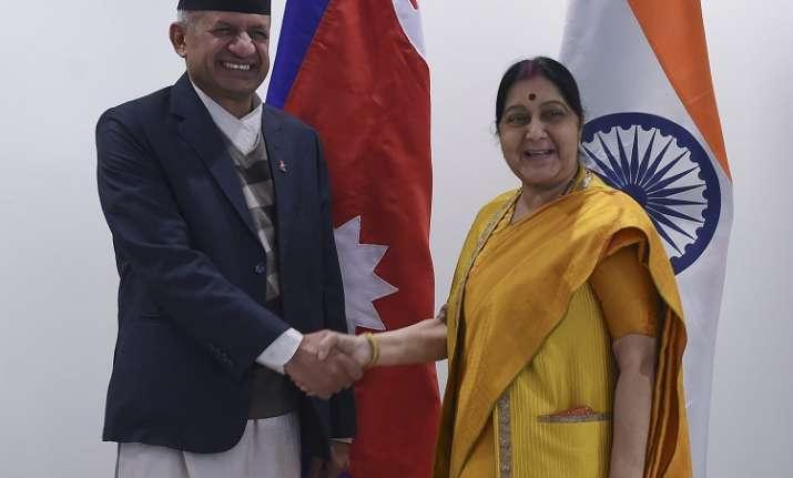 External Affairs Minister Sushma Swaraj greets her Nepali