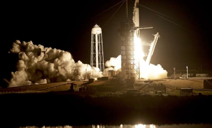 Crew capsule rockets toward space station with test dummy