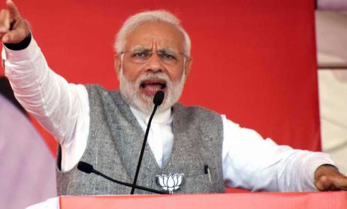 Image result for Modi urges Rahul, others to motivate voters