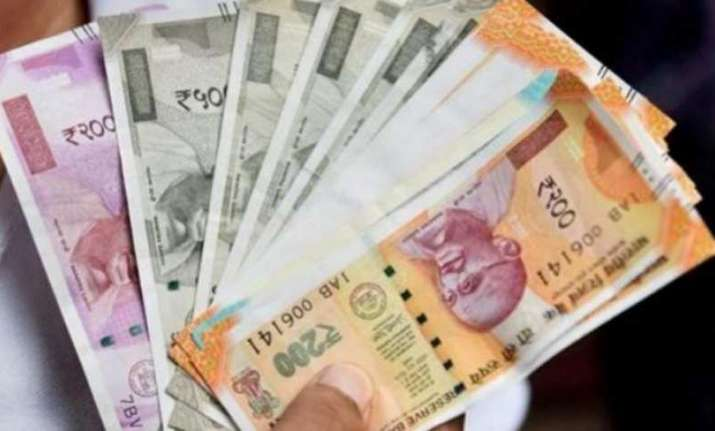 Rupee slips in early trade
