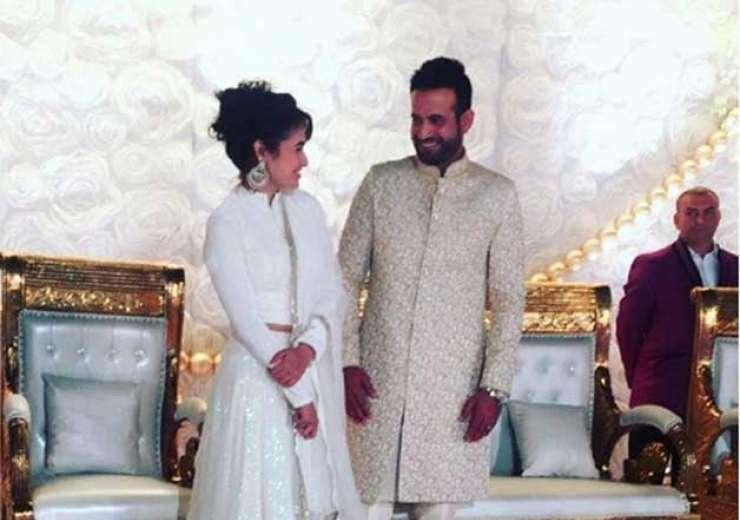 Irfan Pathan and Yuvika Chaudhary sharing a light moment at the function. - India Tv