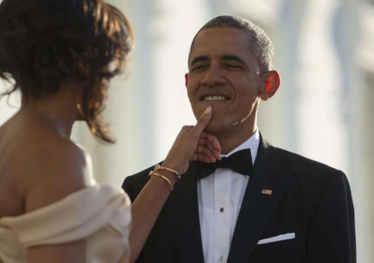 Michelle Obama touches President Obama'a chin as they wait for the arrival - India Tv