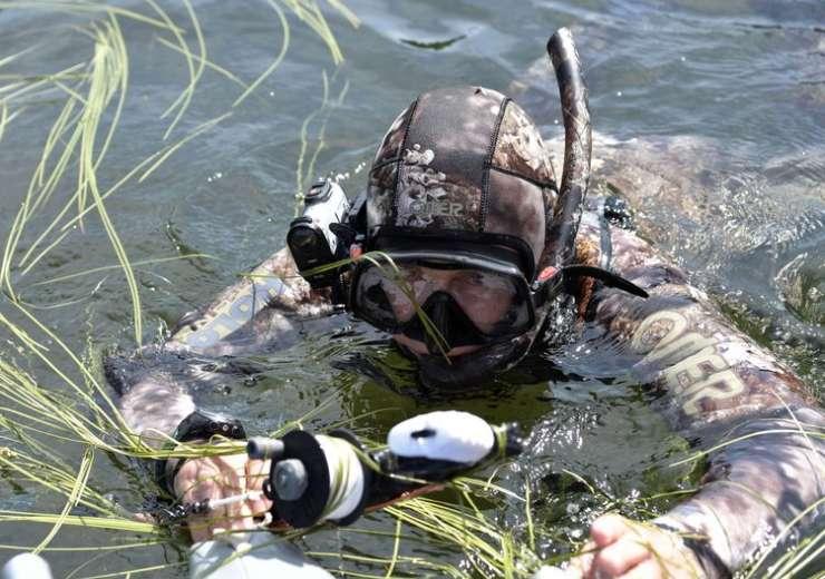 Putin swims during a mini-break in Siberian Tyva region - India Tv