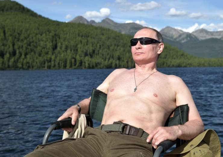 Putin rests after fishing during a mini-break in Siberian Tyva region - India Tv