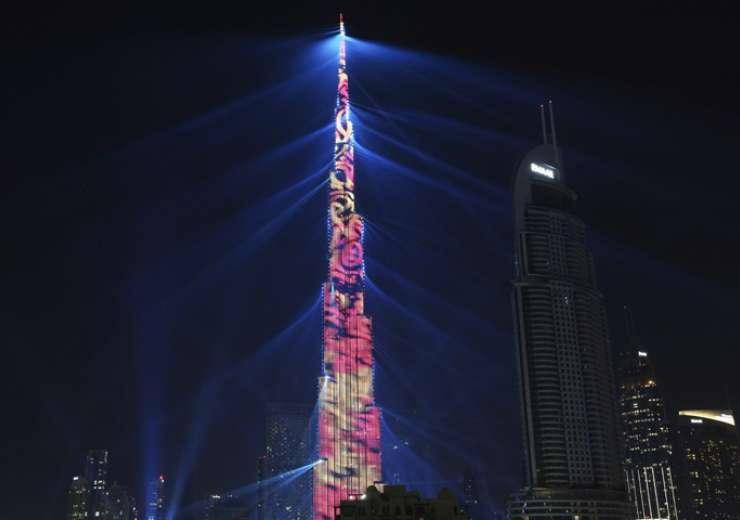 An LED light show illuminates the Burj Khalifa, the world's tallest building, to celebrate the New Year in Dubai - India Tv