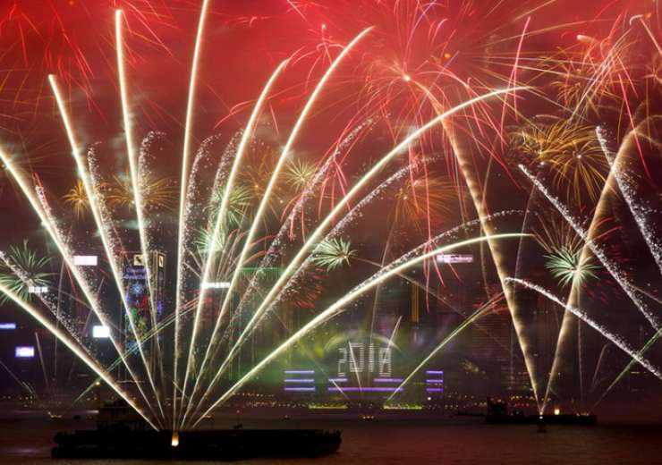 Fireworks explode over the Victoria Harbor during New Year's Eve to celebrate the start of year 2018 in Hong Kong - India Tv