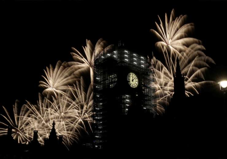 Fireworks explode over the River Thames behind the Elizabeth Tower which contains the bell known as