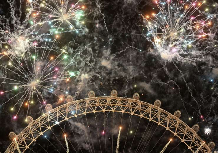 Fireworks light up the sky over the London Eye in central London during the New Year celebrations - India Tv