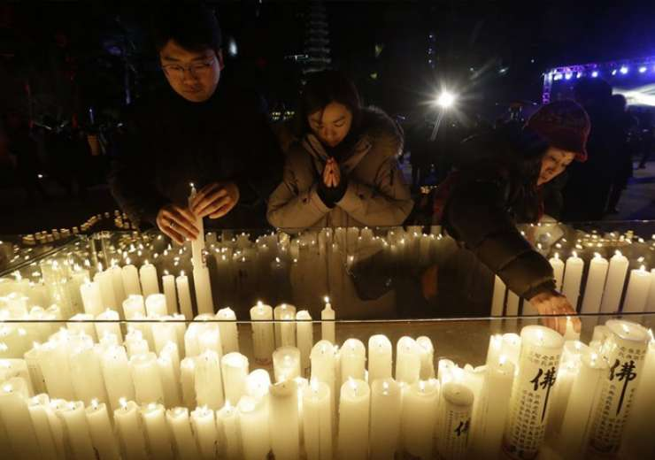 Buddhists place candles during New Year celebrations at Jogyesa Buddhist temple in Seoul - India Tv
