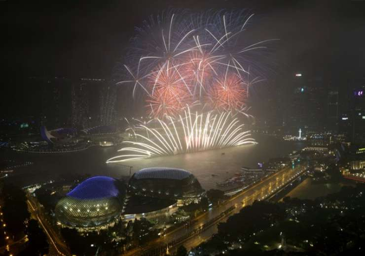 Fireworks explode above Singapore's financial district at the stroke of midnight to mark the New Year's celebrations - India Tv