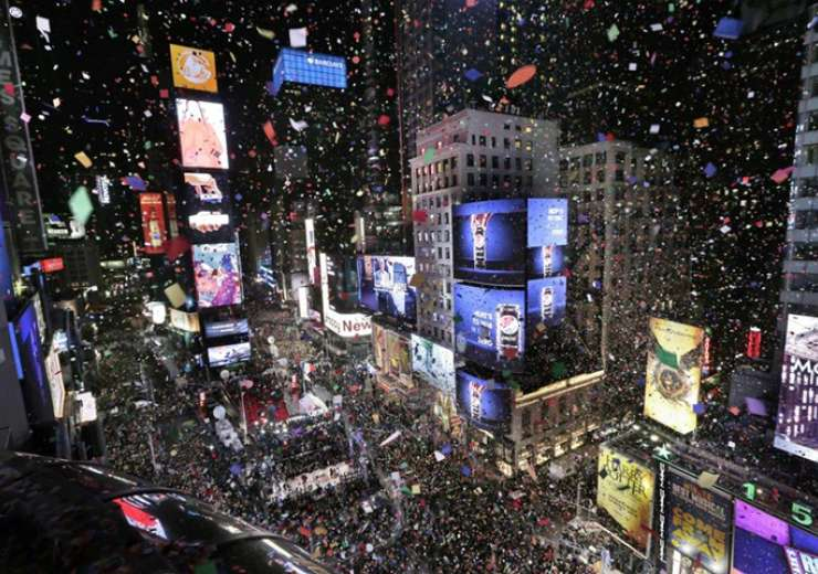 Confetti drops over the crowd as the clock strikes midnight during the New Year's celebration in Times Square - India Tv