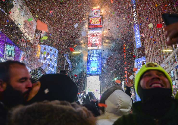 People celebrate New Year as confetti fall down after the countdown to midnight in Times Square - India Tv