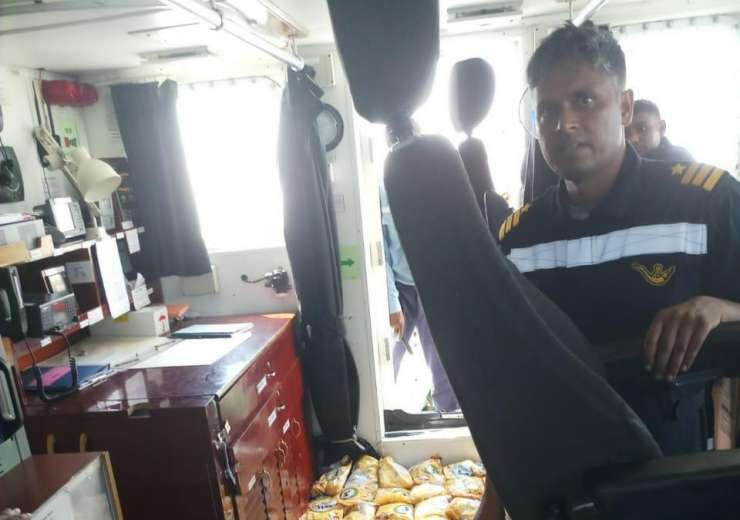 Indian Coast Guard with seized Pakistani boat Al Madina. Heroin worth Rs 6 billion captured. - India Tv
