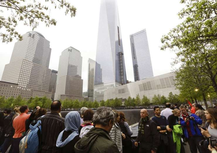 Visitors gather near the pools at the 9/11 Memorial in New York. - India Tv