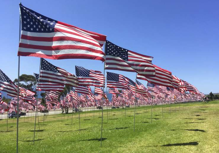 Thousands of flags representing each of the 9/11 terrorist attack victims. - India Tv