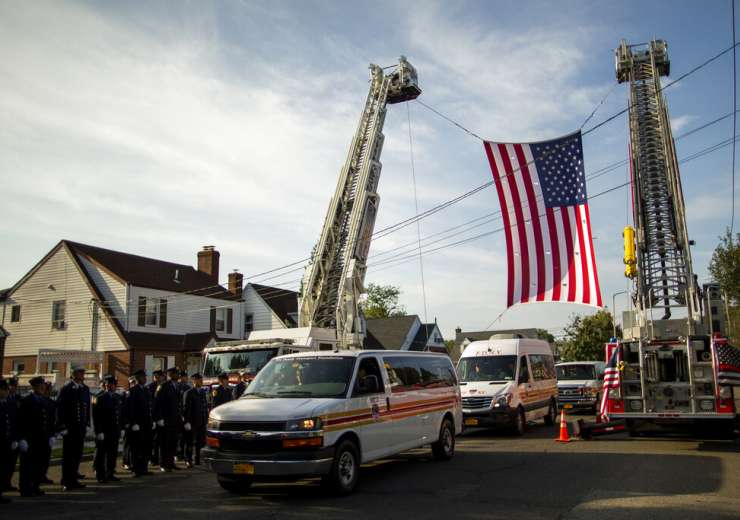 Vehicles of the New York Fire Department in Franklin Square, to attend the second funeral service of the firefighter from New York on the eve of the 18th anniversary of 9/11. - India Tv