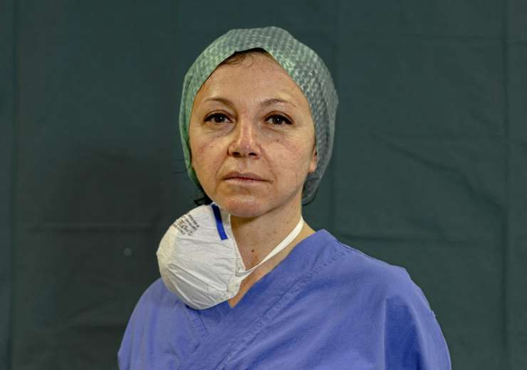 In this image taken on Friday, March 27, 2020, intensive care unit nurse Michela Pagati, 48, poses f - India Tv