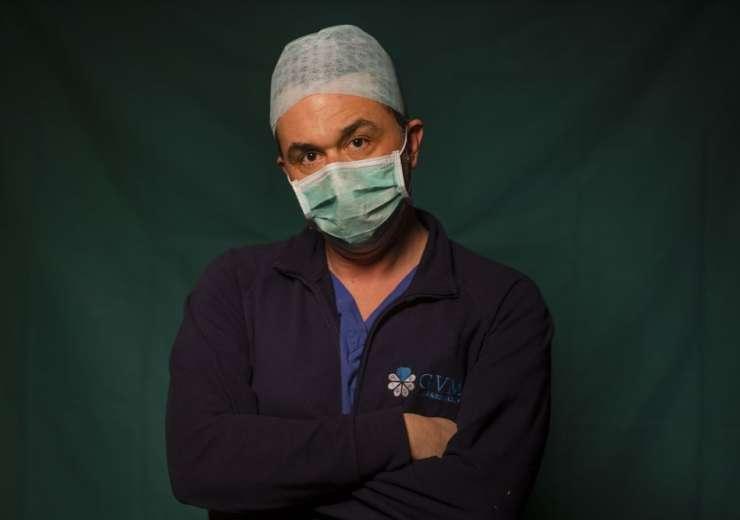 Mirko Perruzza, 43, a nurse at Rome's COVID 3 Spoke Casalpalocco Clinic, poses for a portrait, Frida - India Tv