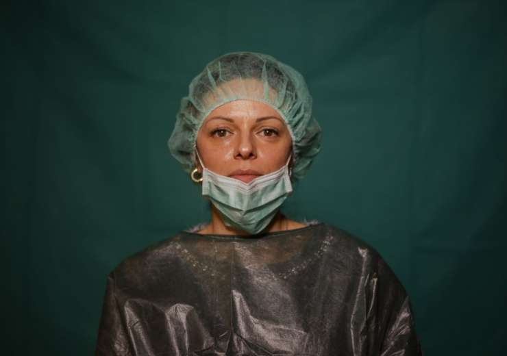 Laura Orsini, 39, an administrative worker at Rome's COVID 3 Spoke Casalpalocco Clinic poses for a p - India Tv