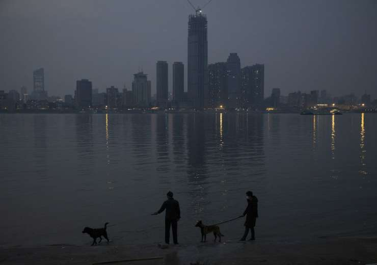In this April 4, 2020, photo, residents wearing masks against the new coronavirus walk their dogs al - India Tv